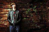 pensive teen standing alone