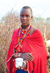 Young maasai woman in traditional dress and jewellry.