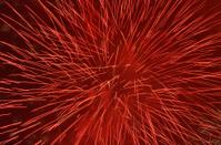 red firework in night sky