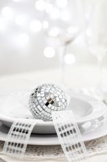 Table setting with disco ball, bow and Christmas lights