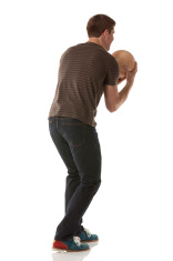 Attractive young man playing with a bowling ball