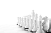 White Chess pieces on board isolated