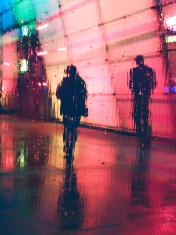 People walking on the street, rainy night