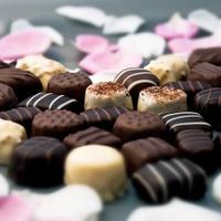 Chocolate truffles and rose petals