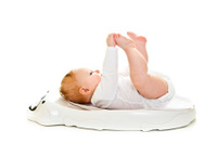 Weighting cute infant girl