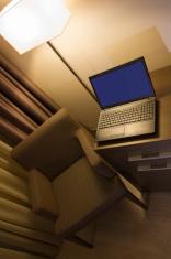 Laptop on desk in hotel room