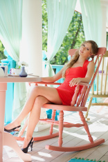 woman sitting on chair and relaxing
