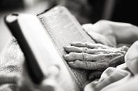senior female elderly woman reading bible