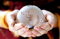 Glass globe in the hands