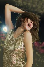 Disco girl in golden sparkling light