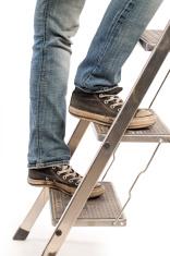 Sport shoes on ladder