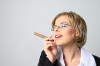 Blond business woman smoking a cigar