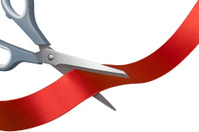 Cutting red ribbon, with clipping path.