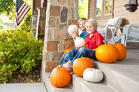 American brothers on home porch with happy smiles in Autumn