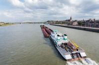 Cargo riverboat passing the Dutch city Nijmegen