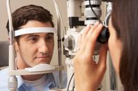 Female Optician Giving Man Eye Test