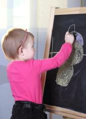 Young girl with blackboard