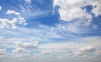 Beautiful blue sky with cirrus and cumulus clouds.