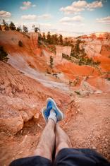 Feet Hang Over a Cliff