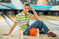 Young man at the bowling alley.