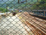metal net and railway station