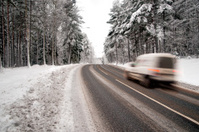 White van on winter road