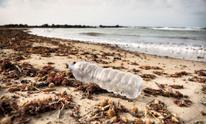 Empty plastic bottle on a beach in Italy