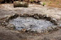 fire pit filled with burnt ash