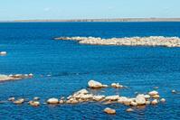 Rocks exposed by low water in reservoir