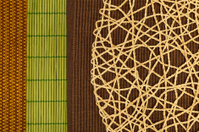 Braided hemp, brown, green bamboo and a golden tablecloth, close