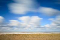 dramatic sky over sand dunes along the Dutch coast