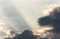 Sunrays in cloudy sky
