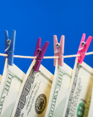 Hundred dollars hanging on a clothesline
