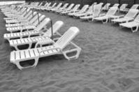 Empty couchettes on beach