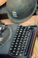 Typewriter and war helmet