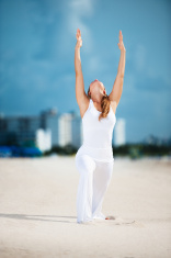 Woman Practicing Yoga Warrior One Pose