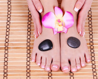 foot care, beautiful female feet and hands with french manicure