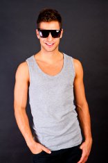 Handsome man in gray tanktop with smile and sunglasses