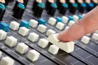 Finger on Mixing Desk