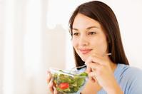 Woman Having Healthy Vegetable Salad