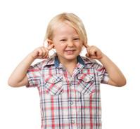Sad boy blocking his ears