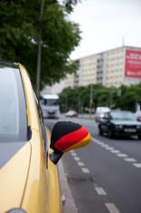 German flag on car wing mirror