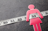 Pink female figure with tape measure