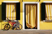 red bike, yellow house