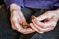 cost retirement senior hand counting money