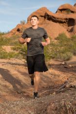 Fit male running thru desert