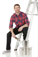 Man with step ladder and paint cans