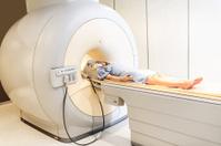 Woman having a medical examination via MRI scan.