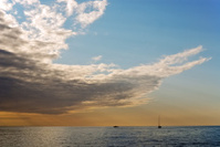 Dramatic clouds at sea with boat