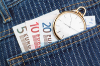Pocket watch in your pants and jeans with money euro.